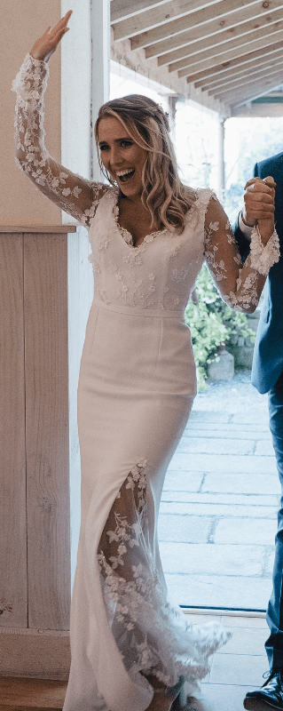 Custom gown by Kathy De Stafford (long sleeve lace with crepe skirt & lace slit)